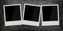 Three Empty Instant Photo Frames On Wooden Table