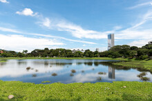 Beautiful Landscape In La Sabana Park With Reflection Of Blue Sky In The Water.