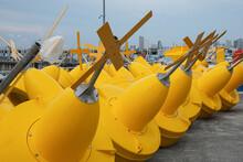 Yellow Buoys At A Port
