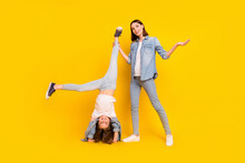 Photo Of Pretty Charming Siblings Dressed Denim Shirts Fooling Standing Arms Smiling Isolated Yellow Color Background