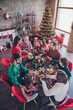 canvas print picture - Vertical photo friendly family having festive christmas dinner on winter holidays indoors apartment