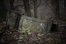 The Fallen Tombstone In An Abandoned Cemetery