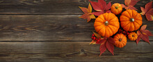 Framework With Pumpkins And Fall Leaves On Wooden Background. Top View.