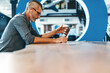 Leinwandbild Motiv Mature businessman speaking during a virtual meeting in an office
