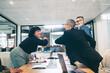Leinwandbild Motiv Cheerful businesswomen elbow bumping each other before a meeting