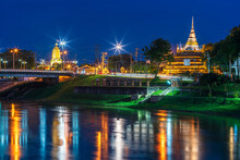 Light On The Nan River On The Naresuan Bridge And Chedi Of Wat Ratchaburana And Prang Wat Phra Si Rattana Mahathat Also Colloquially At The Nan River And The Park At Night In Phitsanulok, Thailand.