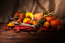 Fall Centerpiece With Pumpkin, Red Peppers And Burlap