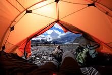 Hiker Enjoy The Beautiful Landscape In Tent