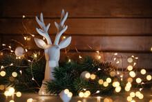 Reindeer Figurine With Christmas Tree, Glowing Garland On Christmas Day