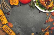 Thanksgiving Turkey Or Chicken For A Festive Dinner. Food Table Background With Autumn Seasonal Specialties For Thanksgiving Day. Fried Chicken With Pumpkin, Vegetables And Autumn Decor On A Wooden