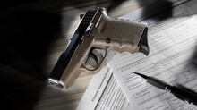 Public Domain Form For An FBI NICS Check To Purchase A Handgun With Semi Auto Pistol And Pen