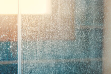 Removing Hard Water Stains And Deposits In Bathroom. Stains Drops On Glass Shower Doors