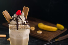 Yummy Milkshake Topped With Cream And Waffles