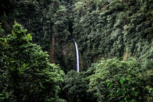 Beautiful View Of The Rio Fortuna Waterfall Flowing Down The Green Mountains