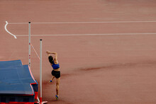 High Jump Girl Athlete Attempt At Competition