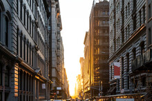 The Light Of Summer Sunset Shines Between The Buildings On 19th Street In Manhattan, New York City