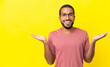 Young latin man isolated on yellow background with shocked facial expression