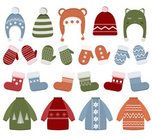 Winter Clothing Set With Hats, Sweater, Socks, Mittens. Clothes With Different Textures Isolated On White Background. Items For Cold Season. Collection Of Warm Clothes For Christmas.