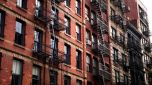 A Patch Of Sunshine Hitting An Old Red Brick Apartment Building In SoHo, New York City.