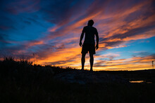 Low Angle Silhouette Of Man Watching Sunset. Wind River Wyoming.