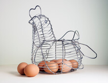 Chicken Shaped Wire Basket Full Of Brown Eggs