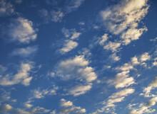 Clouds In Dark Blue Sky