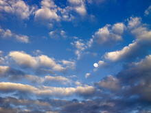 Clouds And Moon In Blue Sky