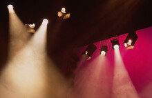 Stage Lights Shining Golden Light With Pink Background