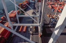 Looking Down From Crane At Wharf Full Of Shipping Containers And Loaded Ships In Port