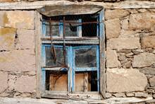 Stone House And Broken Window