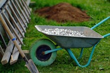 Aluminum Trolley With Crushed Stone In The Village