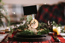 Reindeer Of Wood With Blank Name Card In Christmas Table