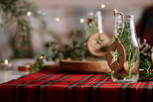 Christmas Table Setting With Wreath And Wooden Ornaments