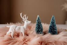 Pink Christmas Table Setting With White Reindeer And Blue Sparkling Pine Tree