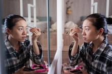 Asian Woman Doing Makeup At Home