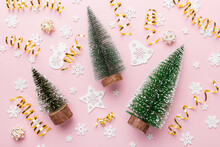 Flat Lay Composition With Christmas Trees On Color Background. Top View With Copy Space