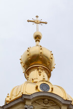 Gilded Dome With A Cross Of The Orthodox Cathedral. Dome Of The Grand Ducal Burial Vault Of The Peter And Paul Cathedral, St. Petersburg, Russia.
