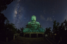 Daibutsu Or 'Giant Buddha' Is A Japanese Term Often Used Informally For A Large Statue Of Buddha, Time Lapse Giant Buddha With Milky Way Moving In Sky At Night, Mae Tha District, Lampang Province.