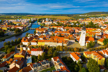 Aerial View Of Old Town Of Czech City Of Pisek On Otava River Overlooking White Belfry Of Church Of Nativity