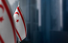 Small Flags Of Northern Cyprus On A Blurry Background Of The City