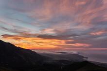 Clouds Descend Over Playa De La Isla At Sunset. Asturias. Spain