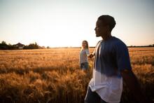 Romantic Couple Walking In Summer Grain Field