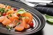 Leinwandbild Motiv Delicious salmon carpaccio served on grey table, closeup