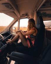 Traveling Woman In Van On Road