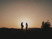 Silhouettes Of A Couple At Sunset