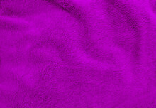 Purple Clean Wool  Texture Background. Light Natural Sheep Wool. Purple Seamless Cotton. Texture Of Fluffy Fur For Designers. Close-up Fragment Purple Wool Carpet.