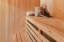 Traditional Old Russian Bathhouse SPA Concept. Interior Details Finnish Sauna Steam Room With Traditional Sauna Accessories Set Basin Towel Aroma Oil Scoop Felt. Relax Country Village Bath Concept.