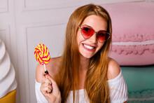 Bright Cute Portrait Of Pretty Blonde Woman Holding Sweet Bright Lollipop