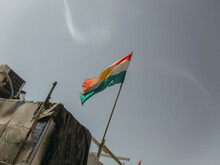 Kurdish Flash On Flagpole Against Clear Grey Sky