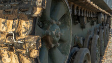 Close-up On Tracks Of A Military Tank. Tracks Of A Tank Fighting Vehicle Or An Armored Personnel Carrier.